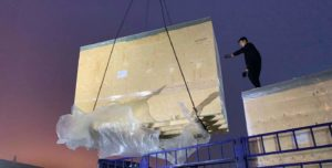 Dimerco arranged a crane to load the oversized cargo from PVG airport warehouse